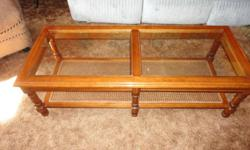 glass and wood coffee table and matching end table.