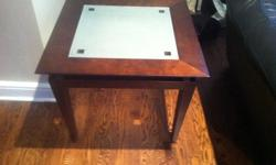 Solid dark wood frame with frosted glass insert. Like new in excellent condition. 60x60x50 end tables(2) 90x90x40 coffee table(1)