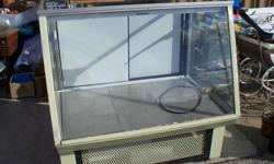 Removed from a restaurant, a Coldstream display unit with 3 glass sides and top, 2 removable glass shelves. It appears to be in working order although it has not been run for a couple of years. It has a stainless removable inside base, and would work well