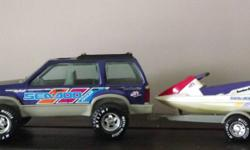 Very Rare Nylint Ford Explorer 4x4 with Trailer & Sea-doo GTS. The Rxplorer has a Folding Tailgate with an Opened Moon Roof. The Wheels on both the Truck & Trailer Roll. The Sea-doo has an Electric Motor powered by two Double AA Batteries that drive a