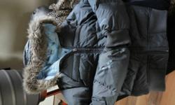 Columbia reversable winter coat charcoal and powder blue wear it anyway you wish. Hood with detachable fur trim. This coat has only been worn 1 season and is down filled. This Fantastic Coat sits at the waist. Jacket is a youth 14/16 or a ladies small.