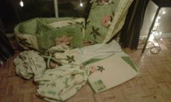 Very nice jungle theme complete crib set well over $300 worth of stuff and was lightly used, comes with the following  comforter flat sheet crib skirt bumper pads mobile valance for window laundry basket 4 medium sized basket covers light switch cover