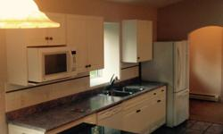 Complete kitchen. Counter included. Available June 15th, 2016 for removal. Main counter/cabinet bank with sink is approx 10'. Island is 6x3. Stove cabinets are 5, and short L piece is 3'