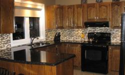 """Beautiful complete kitchen for sale. Includes oak cabinets, granite countertop, fridge, stove, dishwasher, hood fan (all black), 2 stools, faucet and light fixtures all in perfect shape. Meaures 9'6""""x11'1"""". Owner is renovating and contractor will start"""