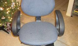 Computer chair with blue cloth on seat and back rest. Adjustable height with roller feet. In great condition.