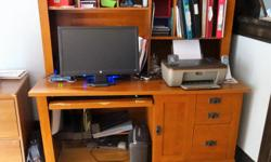 Large computer desk with hutch. Has keyboard tray. Good condition. Phone 705-949-4874