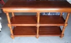"""Console table is largely solid wood, only bottom two shelves are not. 3 months old, excellent condition. 18""""W x 54""""W x 34""""H"""