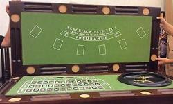 Selling a brown bar, in good condition tha converts into a gaming table. It has roulette, black jack and more. Comes with two stools. Pick up only.