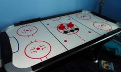 I am selling a Cooper Air Hockey Table.  This is a great table, larger then the usual walmart tables and is very solid and heavy with a strong fan.  Comes with two paddles, a few pucks and all hardware.  Works perfectly but has been disassembled for