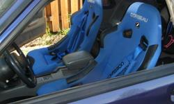 Selling 2 Corbeau Blue and Black racing seats with harnesses and pads, like new asking $525. If interested call (807) 767-9249.