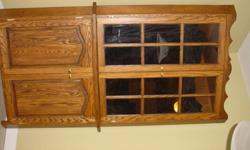 This Is a beautiful corner cabinet, it was hand built by my uncle 15 years ago it weighs a lot call 653-3324 to make an offer