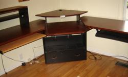 Good condition, lots of surface space to work at, large storage drawer in corner bottom.