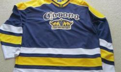 For Sale: Corona `Extra` hockey jersey. Size: XL-Mint condition - `Extra` on back. Perfect if your in a beer league !! $20.