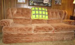 Couch and matching chair in good condition. Asking $150