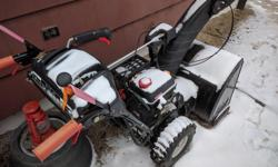 208cc Engine, Electric start (works like a charm!), Headlight, turn control for snow chute, 6 forward / 2 reverse speeds, Steering controls. Used less than a dozen times in 3 years, Operators manual included.