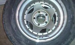 great rims came off my 4x4 gmc jimmy so will fit and vehicle with the same bolt pattern  rims have a bit of rust starting so they willl need a good cleaning   tires are alll season rubber  NEED GONE ASAP AS I DONT OWN THE TRUCK PICK UP TODAY ILL TAKE 25$