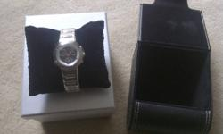 Brand new ladies wristwatch Comes with leather case. Sells for over $220 but have no need for it so would like to sell it for $95 Would make an excellent Christmas gift 705 735 6788