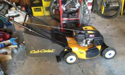 this mower has rear bag or side shoot and mulch excellent condition