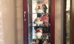 Curio Cabinet in solid wood and veneer. Has glass front door with 5 glass shelves. Can be mounted on wall or set on a mantel. Like new condition.