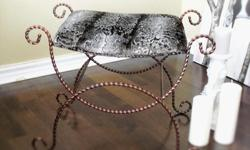 It is newly redesigned and refinished. New fabric, new foam, new painting. This charming ottaman/bench features aged cast iron base with an copper paint finish. The aged iron finish on the legs adds an antique element to the clean, modern lines of the