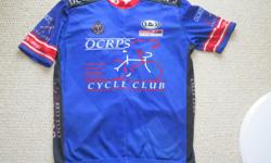 For Sale: OCRPS cycle jersey by Louis Garneau. 1/3 chest zipper and 3 pockets at back. Sized L- Adult Made in Canada- silky smooth. Mint condition.- $20.
