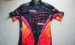 For Sale : Sugoi cycling jersey-Made in Canada for Rona MS Bike Tour Size - Large . Mint condition. Long neck front zipper,3 back pockets. $15.