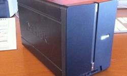 This is a D-Link DNS-321 Network Attached Storage enclosure. It is a 2 bay system that supports SATA drives configured in a a RAID-0, RAID-1, or JBOD configuration. It has a built in UPnP server for streaming video to media servers. The connections are