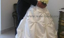 Beautiful Ivory Wedding dress.  Paid $1500.  Will sell for $600, or a reasonable offer.  Will fit 5ft - 5.5 ft, and dress size 10-14.  The back of the dress has a zipper, as well as a corset back.  The long train of the dress can be busseled two ways