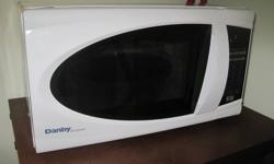 Danby Designer Microwave, Like new - 6 month old -model DMW799W, 700W - 10'' x 17.5'' x 11'' -white microwave - 0.7 Cubic Foot Danby?s counter top microwaves are not only practical and economical, they?re stylish too! Danby microwaves are well suited for