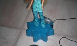 Music plays and Barbie dances to the music. With the head set the kids can sing to the music in the microphone. In excellent working condition.