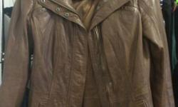 Selling my small, brown leather jacket. It includes leather care package. I worn it once. Email me or text me 647 458 8514