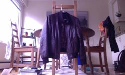 I am selling a brown leather Danier Jacket, womens medium. Texting or calling is the best way to reach me.