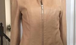Gorgeous camel coloured soft as butter leather jacket with zippered front and zippered lower sleeves. Perfect over a black turtle neck! In brand new condition. Size XS.