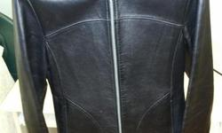 Selling a new condition Danier Black leather jacket. Size is small - includes garment bag Local Pick up Preferred
