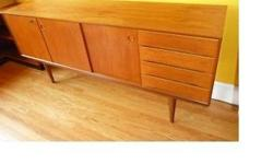 """Solid Teak, in beautiful original condition. Made in Norway, for """"Bahus Gustav ( Kvalitat stamp on back) Design Attributed to Fredrik A. Kayser. Elegant Mid-Century Modern piece Similar pieces are valued at 3000-3500 US Dimensions: 68.5 """"wide 17"""" deep 31"""