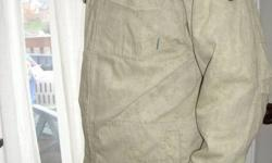 2 layered coat, with a zip sweater inside. Paid over $100.00 for it about 2-3 years ago, but still in good condition. All button fastens, zippers and pockets are still in excellent condition. Coat is not stained, it has a camo print under it, which makes
