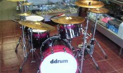 Includes everything in the pictures stands all hardware cast hoops 7 cymbals double kick pedal stool $1800 these drums are at Valente's Music 78 S.Algoma Street a real stand out set with a pink to black finish. I have spent more then 2500 on this set so