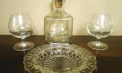 Brandy decanter (with starburst detail) and glasses. Will include bowl for free.