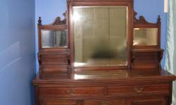 Decoratively carved antique hutch. Hutch comes in two pieces, cabinet and mirror. Hutch has 3 drawers and 2 cabinets. Pickup only, Orleans. Total height 83 inches Cabinet height 38 inches Depth 19.5 inches Mirrors are beveled.