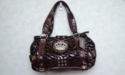 For Sale: Many designer purses. Regularly $80 each, selling for $30 each. Call 780-750-7343 and ask for Melissa.