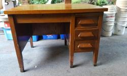 Solid wood / veneer office desk. Three side drawers. One main drawer. Pullout shelf. Obvious signs or wear. No delivery. Pickup Saturday pm Dimensions: W= 107 cm D=77 cm H=79 cm