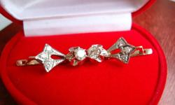This Diamond Earrings and Diamond Ring Set in Platinum makes an extraordinary present for special someone. Diamond Earrings Each center diamond is prong set and surrounded by three brilliant pave set diamonds in these one-of-a-kind earrings. The durable