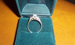 I have a lovely diamond engagement ring appraised September 8, 2011 at $1,670.00 replacement value. Purchased at People's Jewelers and appraised at Graham's Jewelers in Courtenay, BC. The centre diamond in the engagement is 0.20 ct. There are a total of 7