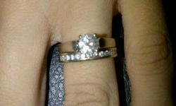Hi. I am selling 2 beautiful rings. The Engagement ring is a lady's 4 prong 14kt. white gold solitaire ring with 1 round Brilliant cut natural diamond. Clarity is I-2. Colour is G-H. Diamond weight is 0.70ct. Value is $3450.00 The Wedding band is white