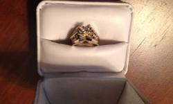 $650.00 OBO One Lady's yellow and white gold and daimond engagement style ring, stamped 14K Please see picture of Appraisal for details sized to a 5.5