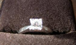 Diamond Ring given to me as a christmas gift. 14 karat white gold ring with 4 prongs.   .70 carat - very good cut. Princess cut natural diamond. Have certificate of origin for interested buyer only. Replacement value is $7,400.00 Willing to sell for about