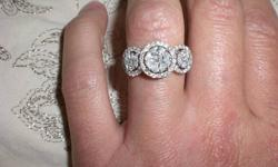 this is a 63 diamond ring. it has brilliant cuts, and princess cuts as well as marquis diamonds. totaling over a carat. size 7.5 and can be resized. its 19kt white gold. and has never been worn.. worth 7,000