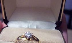 I am offering a 14kt yellow gold, six claw 0.3ct diamond solitaire ring.  It has a brilliant cut I-1 clarity, H-1 colour diamond.  It comes in the original Peoples box, and with a gemscan certificate of evaluation valuing the ring at $1425  I believe the
