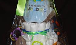Looking for memorable baby gift? Diaper cakes are always a hit at any baby shower...but can be time consuming and tedious. Allow me to create a one of a kind gift for Mom-to-be that includes an assortment of special items.  Basics include: brand-name