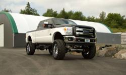 THE GARAGE Performance Parts and Accessories Here at The Garage we have tons of programmers, intakes and exhaust systems in stock for many late model Dodge, Ford or Chevrolet. If you?re looking for more power and torque to pull your trailer down the